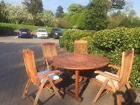 BillyOh solid teak circular garden table and 8 matching teak folding chairs