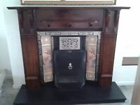 Wooden fireplace with cast iron surround - perfect condition