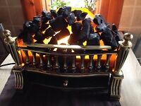 Electric fire with real coal.