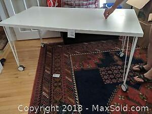 White Ikea Table On Casters.