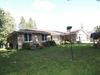 "EXECUTIVE HANOVER HOME ON NEARLY 3/4 PRIVATE ""RAVINE LOT""."