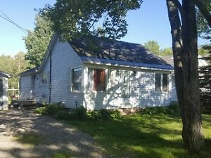 NEW PRICE!Country living in the City! 3 bdrm home + 2 car garage