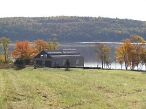 6 Acres of Waterfront with Boathouse!