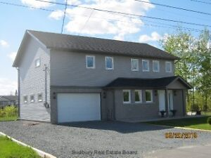 CUSTOM BUILT RAISED RANCH STYLE HOME IN VAL THERESE
