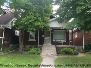 SOLID BRICK & VINYL 1.5 STY HOME IN GOOD LOCATION