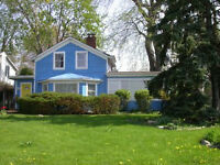 Heritage home on large lot overlooking Goose Bay Park and river