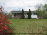 WELL BUILT HOME, NICELY MAINTAINED WITH GARAGE & WORKSHOP
