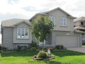 Beautiful side split 4 bedroom 3 and a half bath home w garage