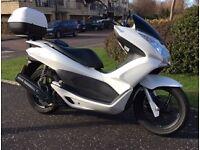 Honda PCX125, white, 2011, matching Givi top box, 7500 miles. Near immaculate. 12 mths MOT