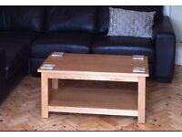Oak coffee table for sale.