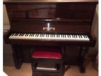 Piano (upright) with piano stool. Needs tuned. Free for uplift.
