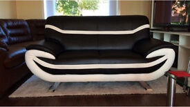 Black and white leather flux sofa can deliver