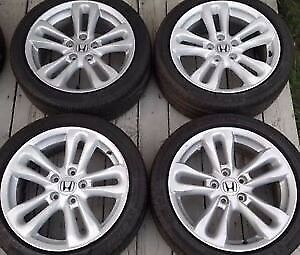 LOOKING FOR A SET OF THESE STOCK CIVIC SI WHEELS
