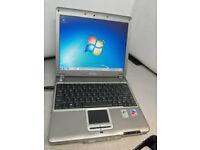 Very thin Dell laptop Windows 7