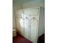 2 matching double cream/white wardrobes with gold coloured decoration