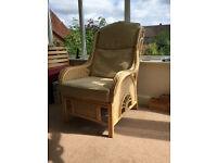 Two seater cane sofa and two cane armchairs with cream cushions