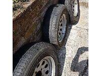 suzuki jimny 4 steal wheels and tyres bridge stone dueler H/T 205/70 r15