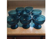 8 blue glass bowls