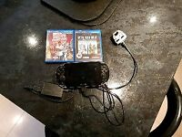 Sony PS Vita with 2 Games and Charger