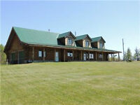 SIMPLY BREATHTAKING! LOG HOME ON 26.4 ACRES BORDERS THE LAKE!