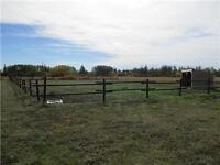 5.96 acres 10 minutes from GP set up for horses!