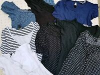 Large bundle of maternity clothes size 12/14