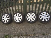 4 X genuine Nissan alloy wheels c/w tyres (very scratched and cosmetically damaged)