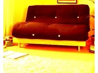 **Wooden sofa bed 2-3seats and double bed.Double colour brown and cream**