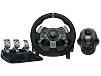 Logitech g920 steering wheel, pedals and gear shifter.