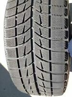 205/65/15 Brdgestone Blizzac winter tires and 5x114.3 rims.