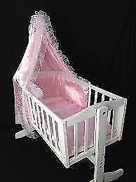 White swinging baby cradle and matress with drape rod