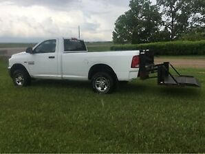 2013 Dodge Ram 2500 4x4 with Power Lift Tailgate.