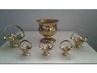 (1) Brass Planter and (5) Brass Flower Baskets.