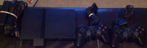 Playstation 2 With 2 Controllers/Memory Card and 20 Games