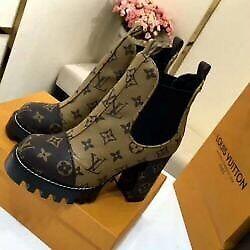 LV boot nice beige on black