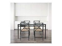 Glass dining table from IKEA with 4 chairs, seats up to 6. Good condition.