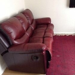 New, clean and stylish recliner sofa along with modern table