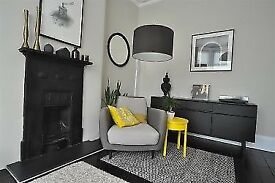 Habitat armchair with square footrest
