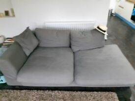 2 very cool low down grey sofas, hand made. Plus large grey foot stool to match