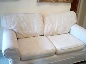 Two seater sofa. White loose cover. In very good condition.