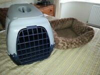 large pet carrier and pet bed