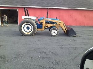 5000 ford tractor with loader bucket