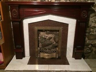 Fireplace with Mahogany surround and Marble inset and hearth