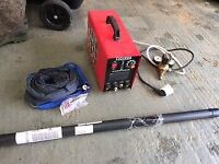 Tig welder with gas adaptor, torch and mild rods.