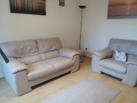 cream leather 2 str and chair and footstool not recliners