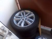 Selling 4 vauxhall alloy wheels, R17 215/50. 3 tyres are ok to use, one is bad. 110£ for all 4.