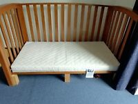 Mamas and Papa's Cot bed with mattress. Cot/bed has 3 sides for gentle transition into single bed