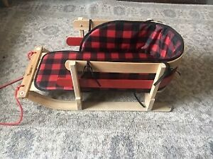 Streamridge Wooden Baby Sleigh with Plaid Pad.