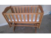 Beautiful wooden crib cot with rocking function; complete with mattress. Very good condition