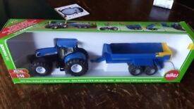 Siku toy tractor and trailer